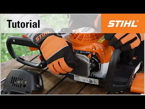 Cleaning the air filter of a STIHL petrol hedge trimmer